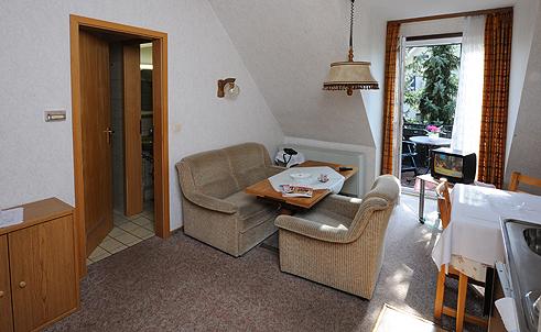 Brunnenhof Appartement - Wohnzimmer